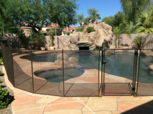 Large pool fence along a ceramic pool deck