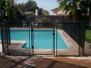 L shaped pool with fence