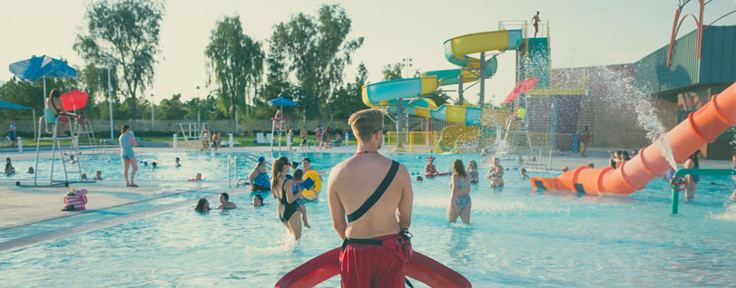 A lifeguard watching swimmers at a waterpark